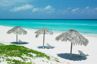 white sand beach and ocean waters