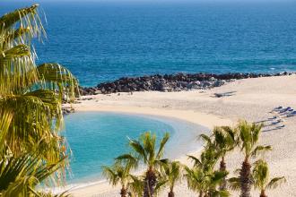 a White sandy beach with blue ocean