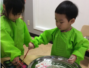 Two children engaging in an activity at the child study centre