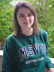 Picture of Alex, a white woman wearing her MSVU Nutrition Sweater