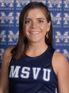 Picture of Grace, a white woman wearing her MSVU track uniform.