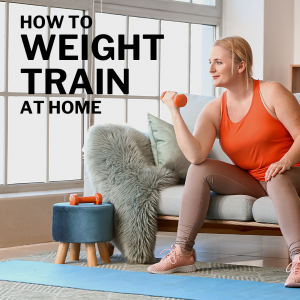 woman doing weight training at home