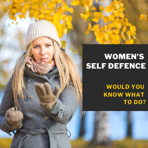 A woman in a park with a self defence pose