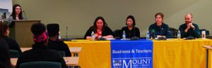 People sitting at table. Tourism and Hospitality Management Career Week panelists.