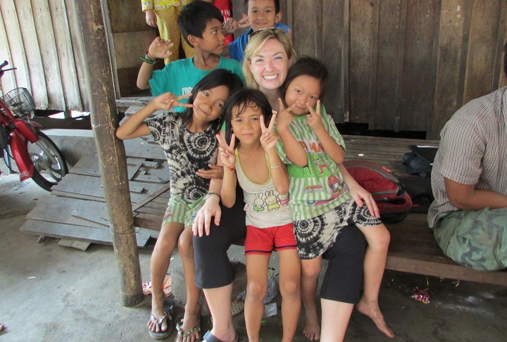 Dr Whitfield with kids in Cambodia