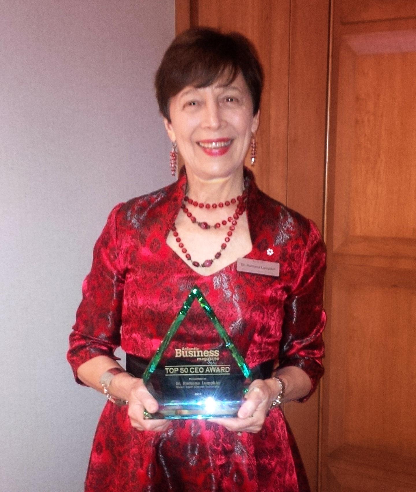 Ramona Lumpkin with 2016 ABM Top 50 CEO Award