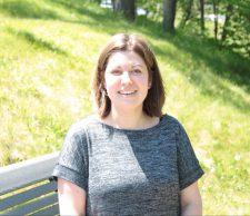 Marisha Caswell sitting outside of Evaristus Hall at Mount Saint Vincent University