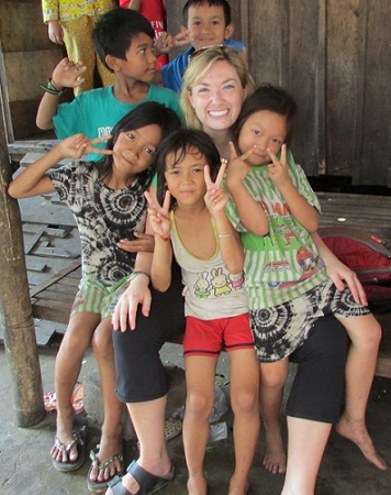 Kyly with children in Cambodia