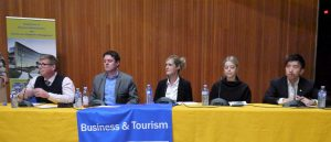 People sitting at a table. Management Career Week Panelists