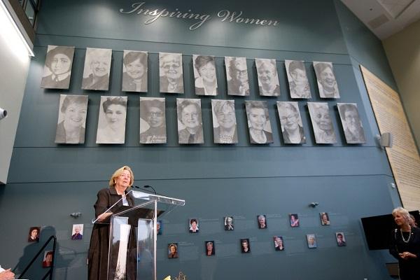 Margaret McCain in front of the inspiring women installation - website