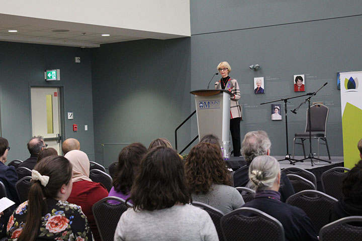 Mary at podium