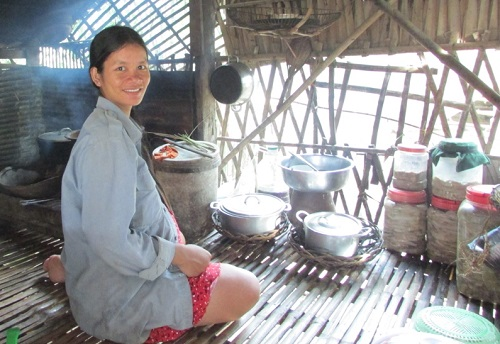 Participant cooking in her kitchen