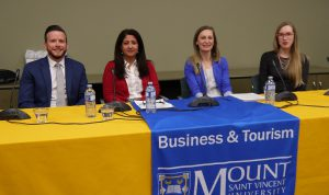 People sitting at a table. Strategic Human Resource Management Career Week Panelists