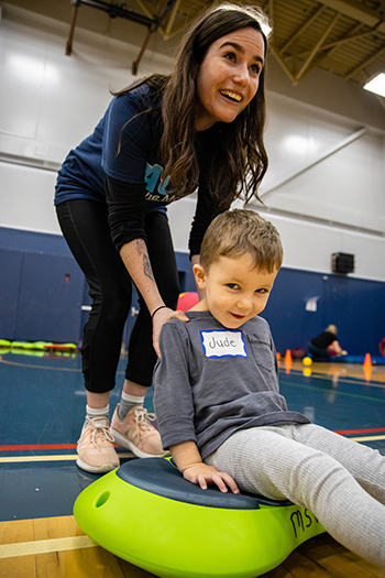 MSVU student and a PACE participant using a stepping stone