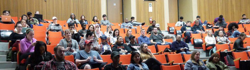 Students sitting in the auditorium