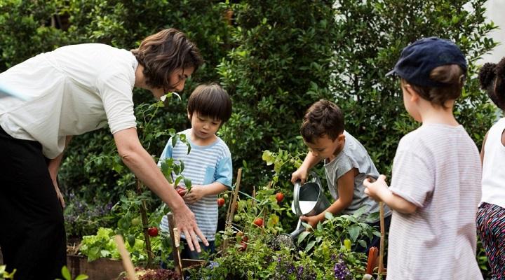 Teacher and kids in a garden