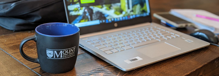 MSVU Coffee Cup and laptop