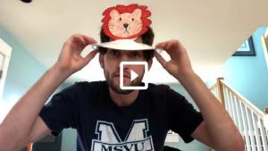 man wearing an animal hat that he made