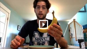man holding a banana preparing a snack
