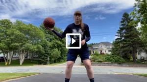 woman playing basketball outside