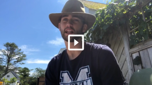 man outside with hat