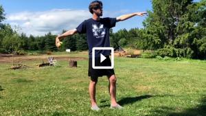 man throwing a softball