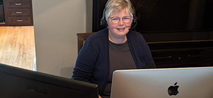 Dr. Kathy Darvesh working on computer