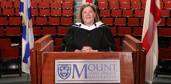 Valedictorian speaking at podium