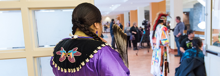 A Women looking over the Mid-Winter Feast event at Mount Saint Vincent University